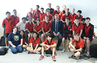 Joss Bland-Hawthorn with students and teachers from Marist College Eastwood.